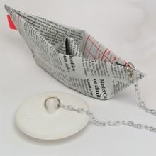 Avloppspropp Tidningsbåt